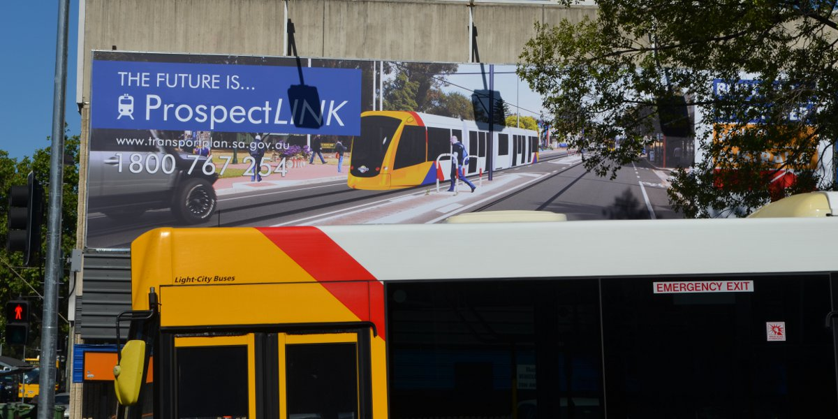 A Government billboard promising a tram through North Adelaide before the 2014 state election.