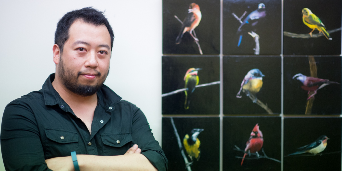 Datsun Tran with his oil painting Night Birds. Photo: Nat Rogers / InDaily