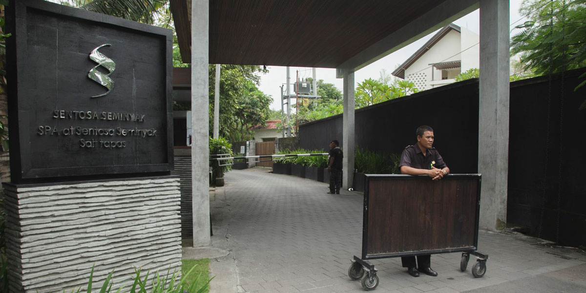 Security guards outside the Sentosa Seminyak Villa in Bali, where Schapelle Corby was reportedly taken after being granted parole.