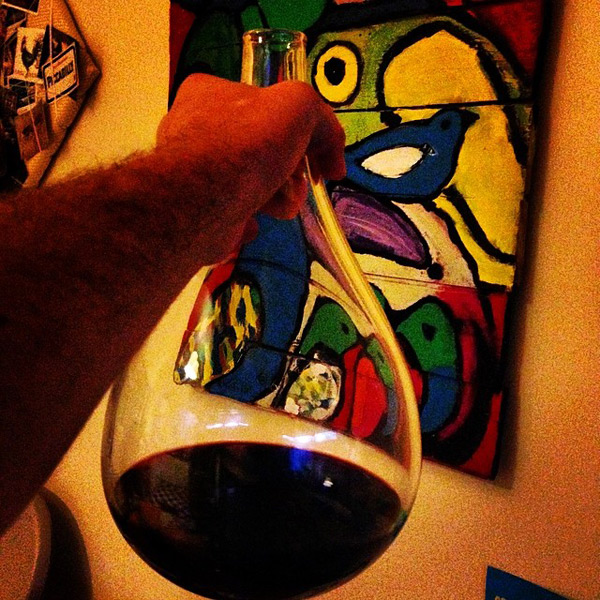 Duncan Welgemoed's selfie of the Twelftree award decanter and a painting by Stephen Langdon.