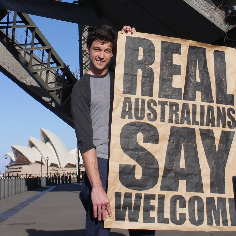 Peter Drew with one of his posters in Sydney.