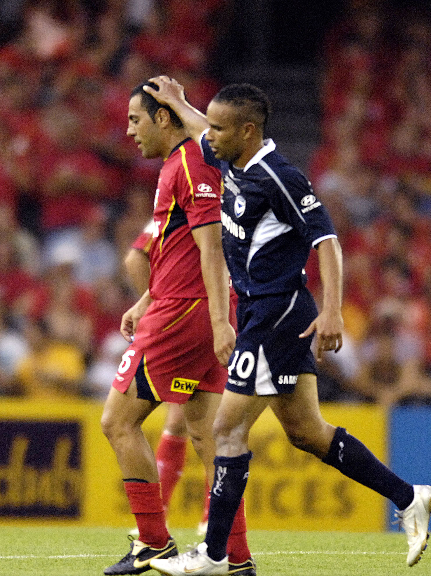 Archie Thompson farewells red-carded Ross Aloisi during United's disastrous 2007 grand final showing. AAP image