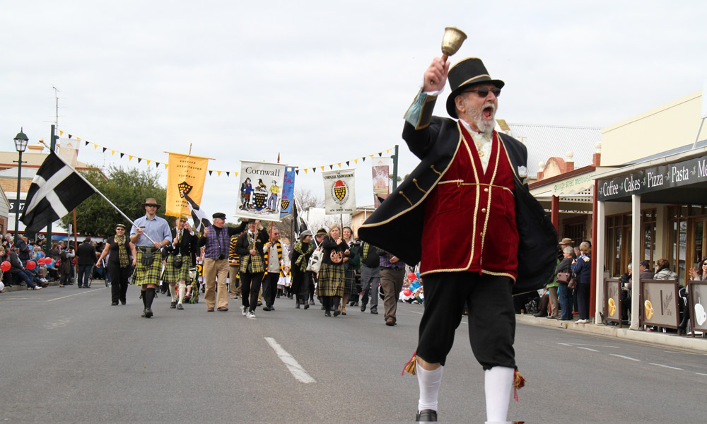 The town crier leads the Kernewek Lowender procession.