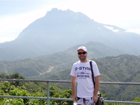 Standing in front of Mt Kinabalu