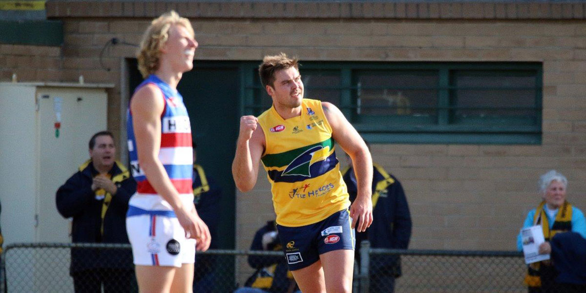 Michael Wundke celebrates a goal during his 100th SANFL match. Photo: Peter Argent