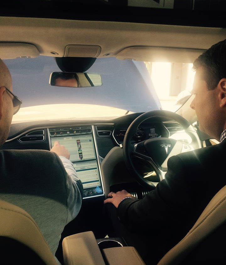 Transport Minister Stephen Mullighan in a Tesla car, with the capacity to drive autonomously. Supplied image