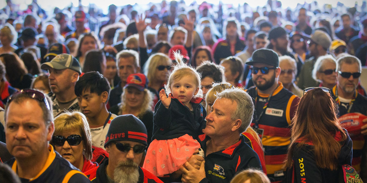 Fans flow in to Adelaide Oval on Sunday to remember Phil Walsh. AAP image