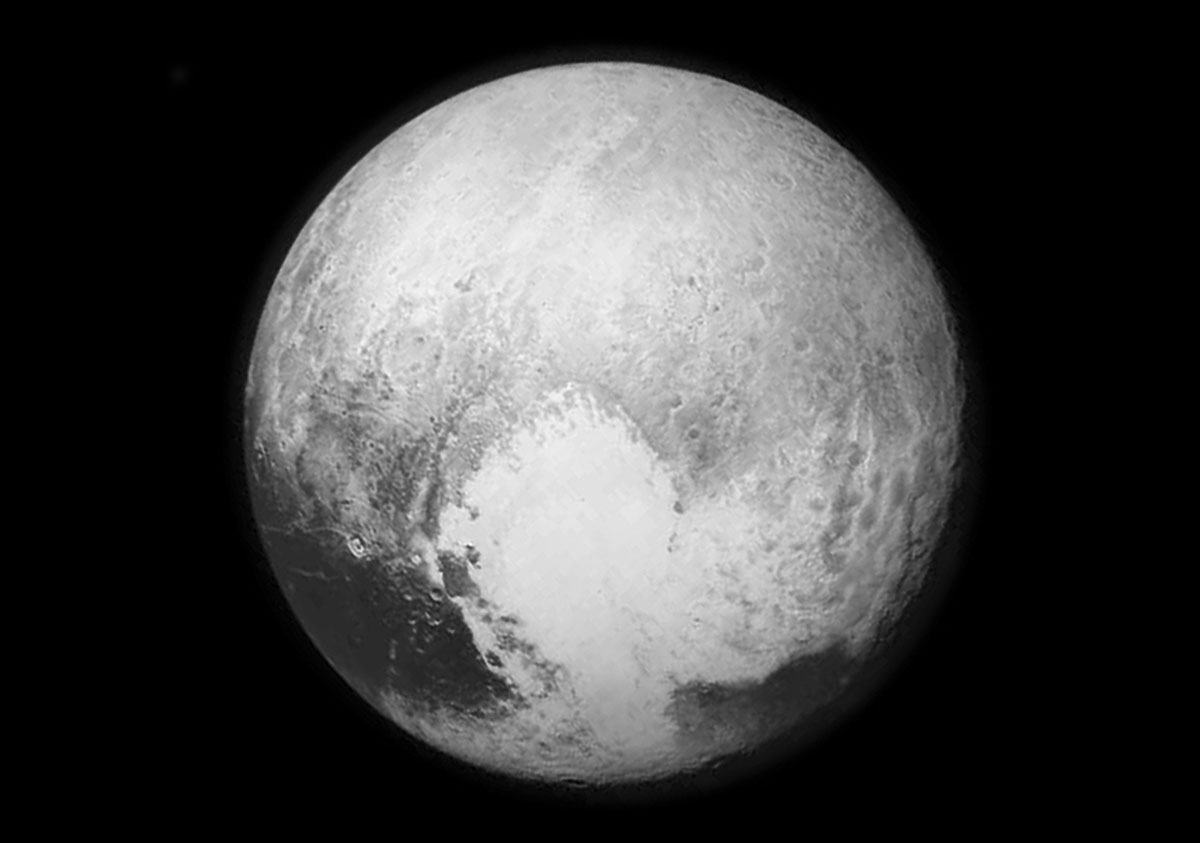 A NASA picture of Pluto taken form the New Horizons spacecraft, 768,000km from the surface. This is the last and most detailed image sent to Earth before the spacecraft's closest approach to Pluto overnight.