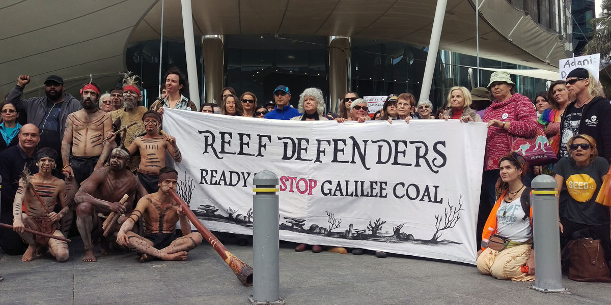 Anti-mining protesters  outside mining giant Adani's offices during a rally in Brisbane in July. AAP image