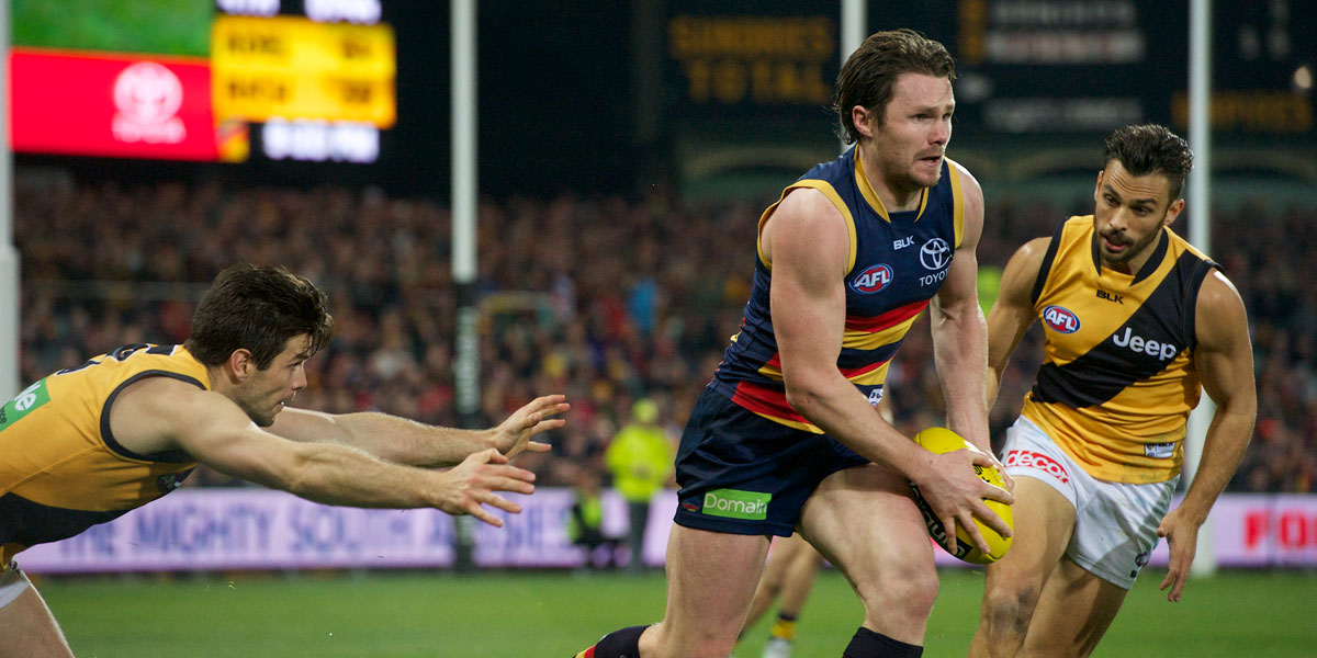 Richmond spent much of the game chasing Patrick Dangerfield. Photo: Michael Errey/InDaily