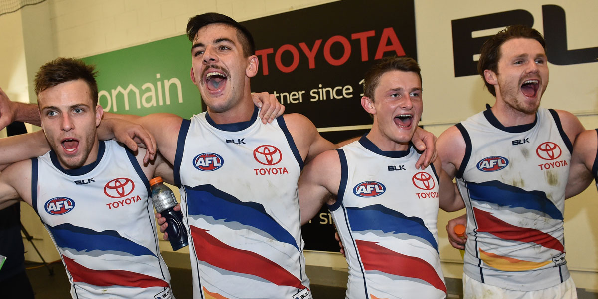 Brodie Smith, Taylor Walker, Rory Laird and Patrick Dangerfield in full voice after the match. AAP Image