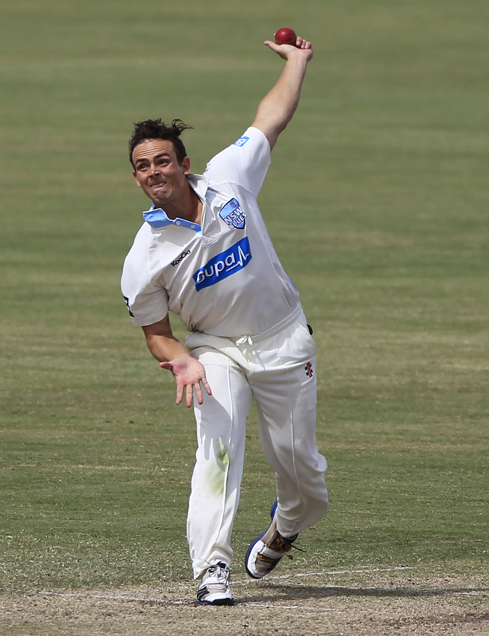 Steve O'Keefe bowling for NSW. AAP image