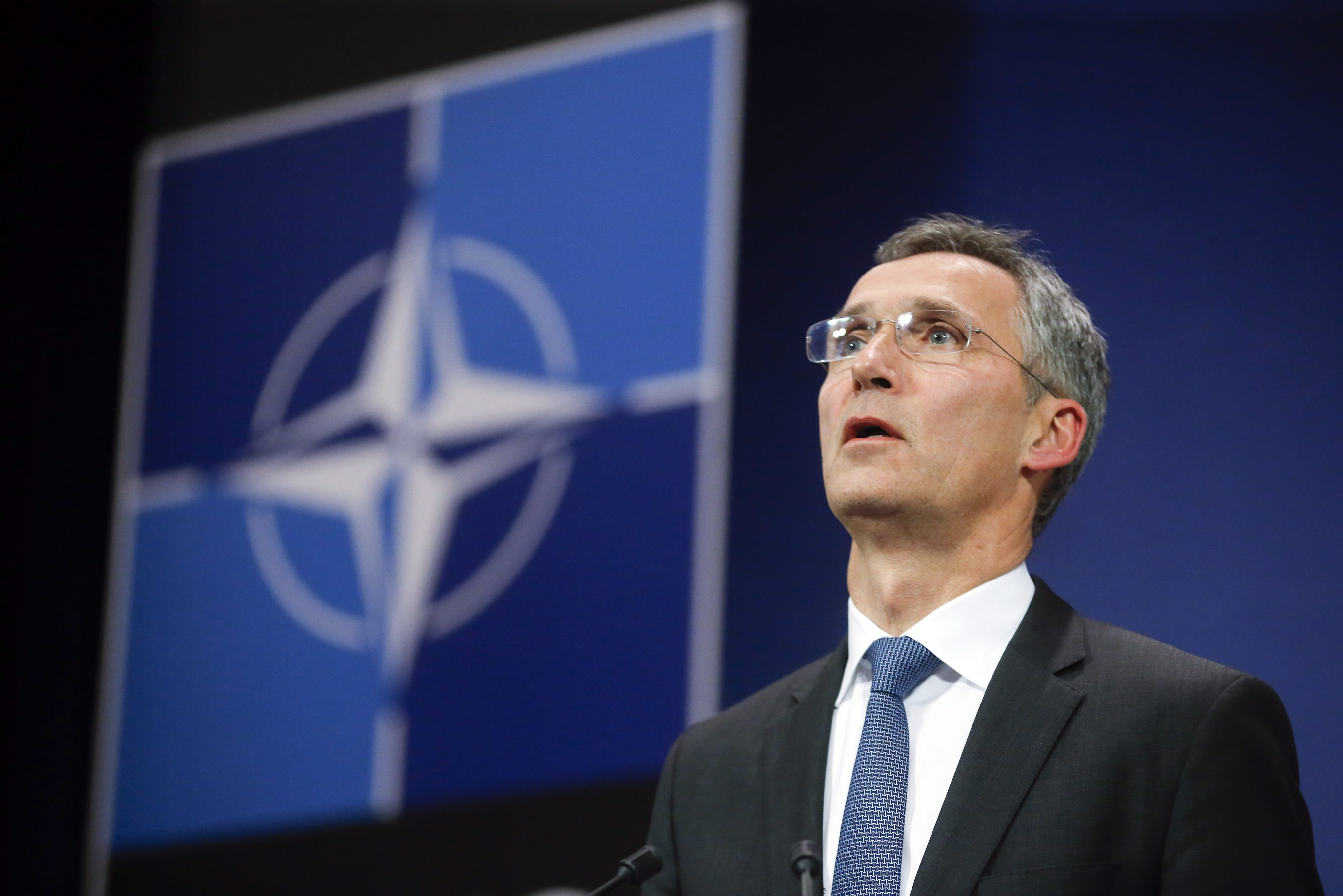 NATO Secretary General Jens Stoltenberg briefs the press overnight. EPA/OLIVIER HOSLET