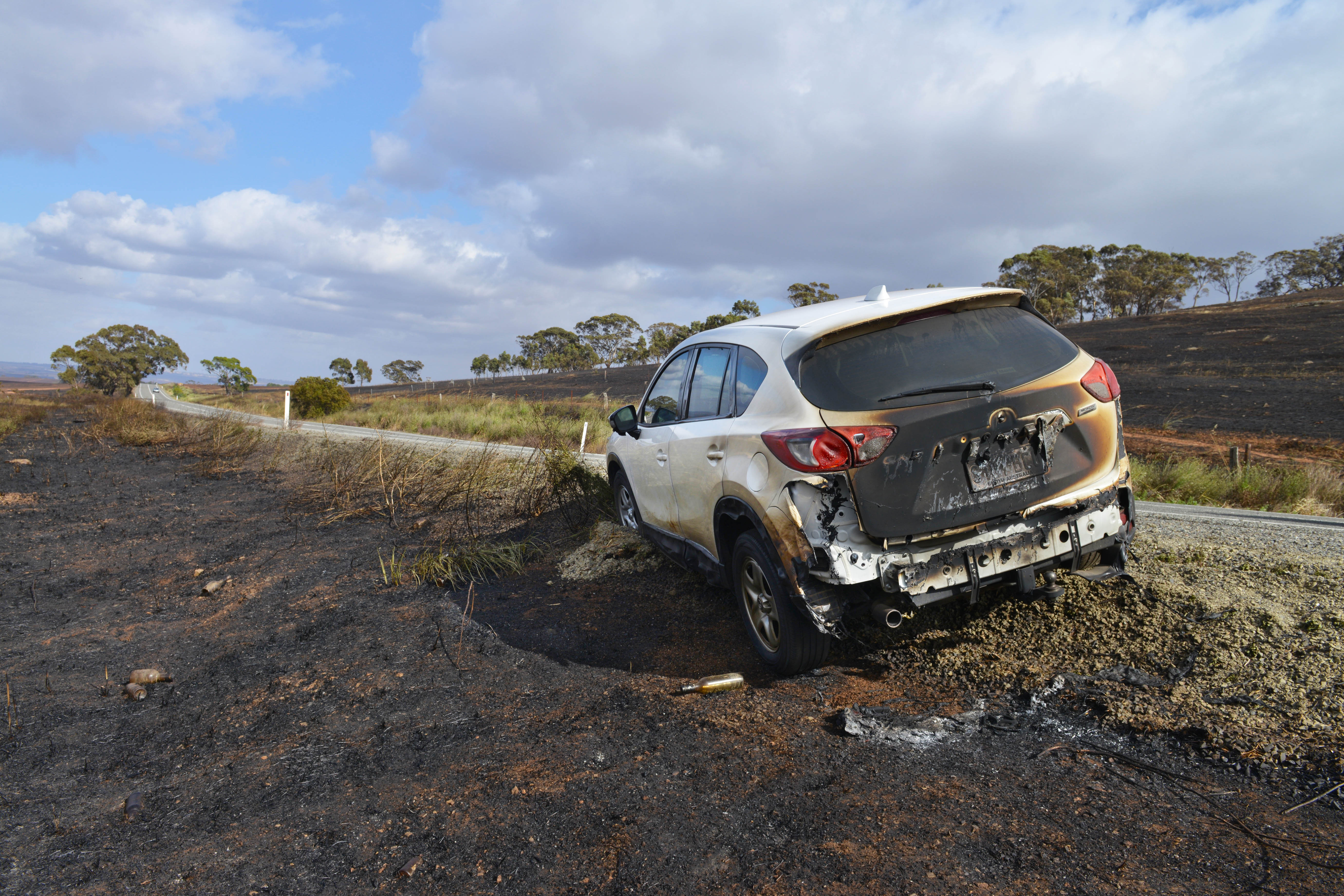 A destroyed car, one of dozens caught in the path of the Pinery fire. AAP Image/Brenton Edwards