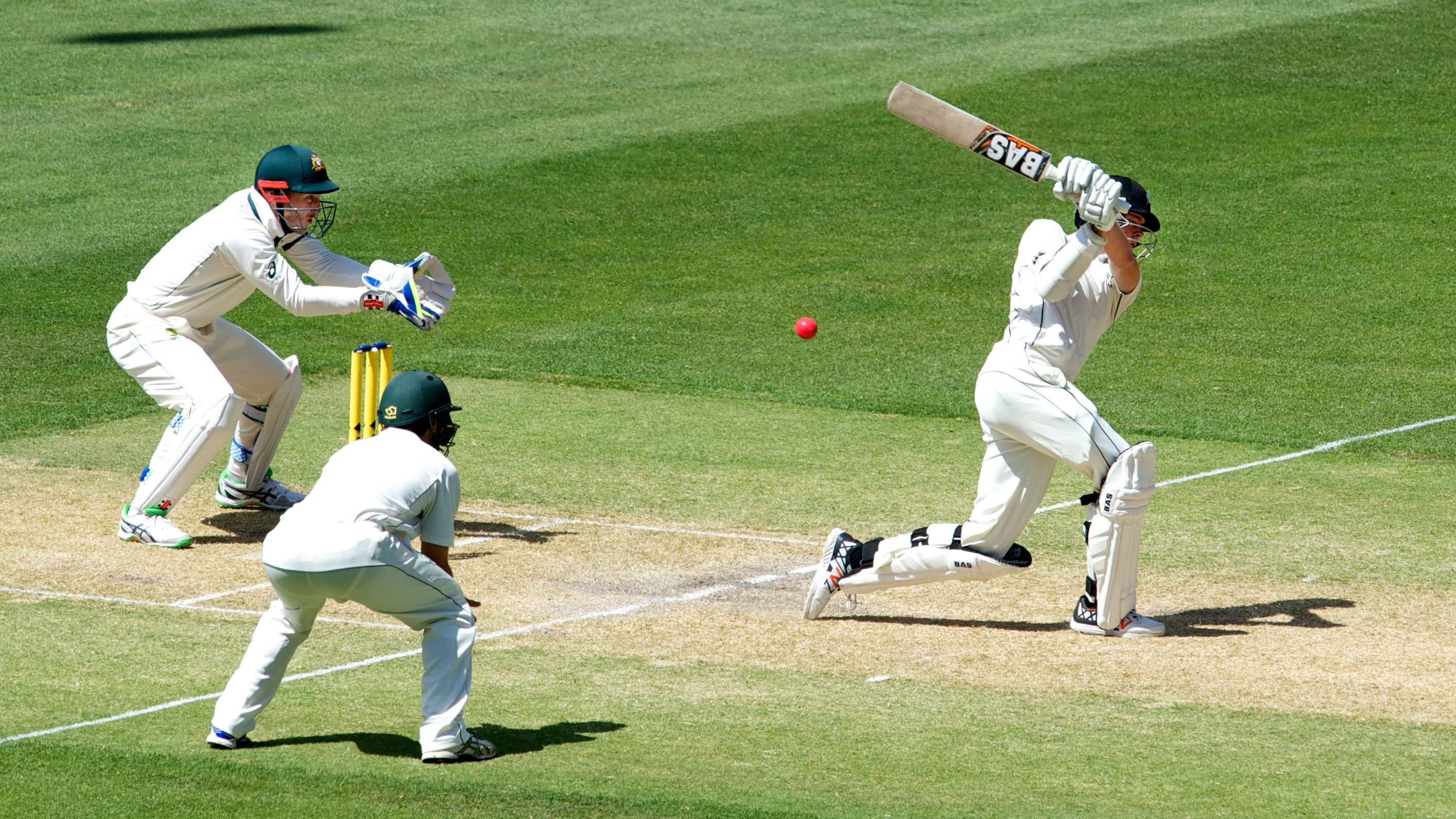 New Zealand's Mitchell Santner swings, misses and end up being stumped. Photo: Michael Errey/InDaily