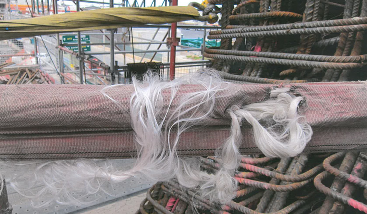 Former Superway workers say this photographs shows a frayed soft sling in use on the project.