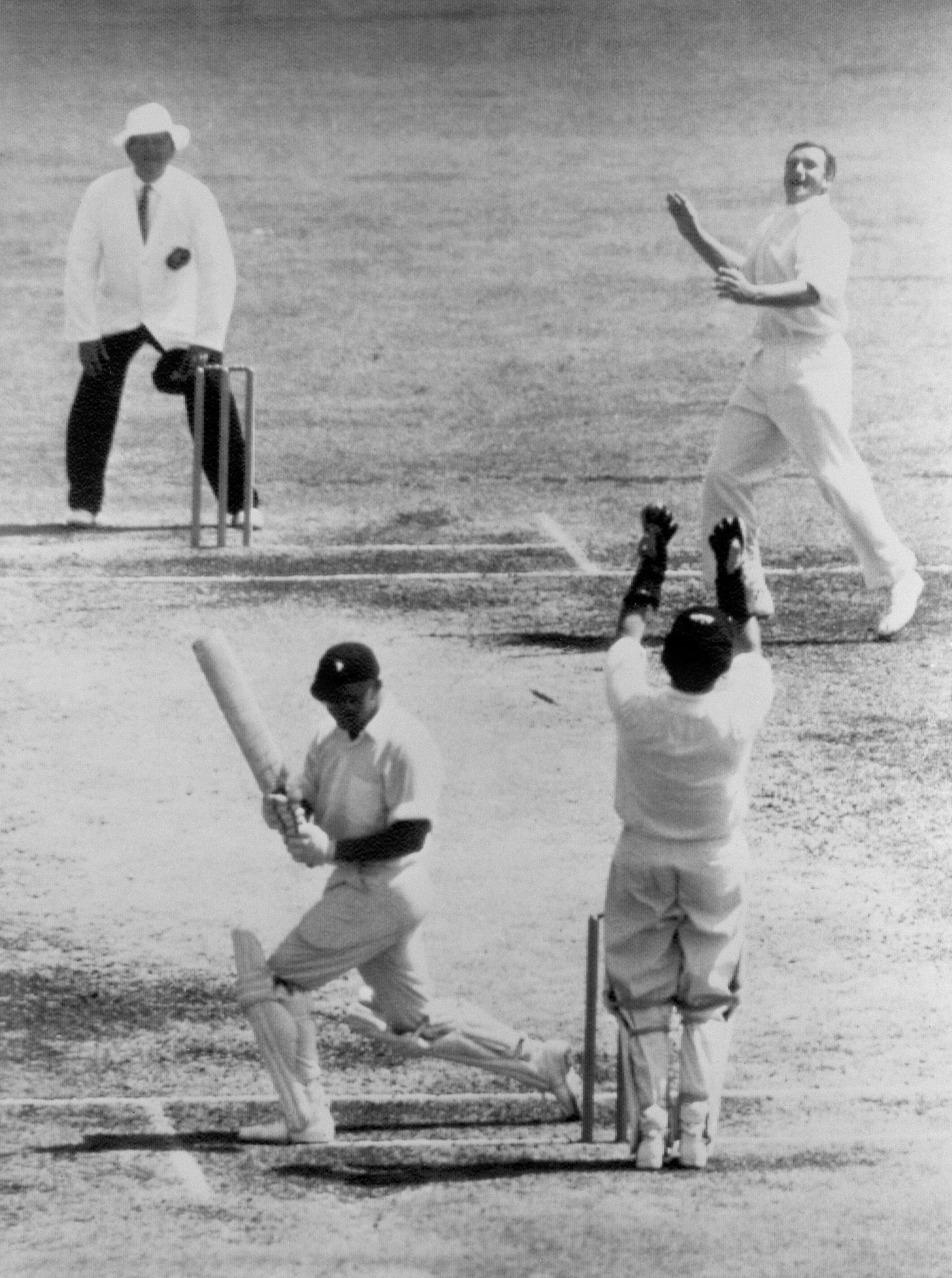 Wally Grout celebrates behind the stumps after Richie Benaud clean bowled South Africa's Eddie Barlow. PA photo