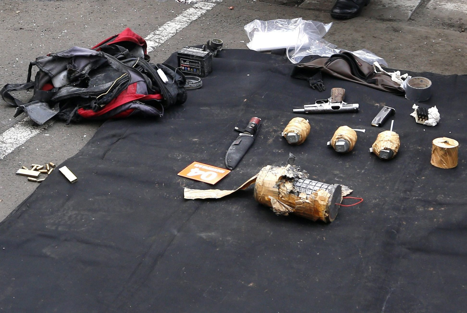 The weapons arsenal suspected terrorists were carrying after a bomb blast in front of a shopping mall in Jakarta yesterday. Photo: EPA