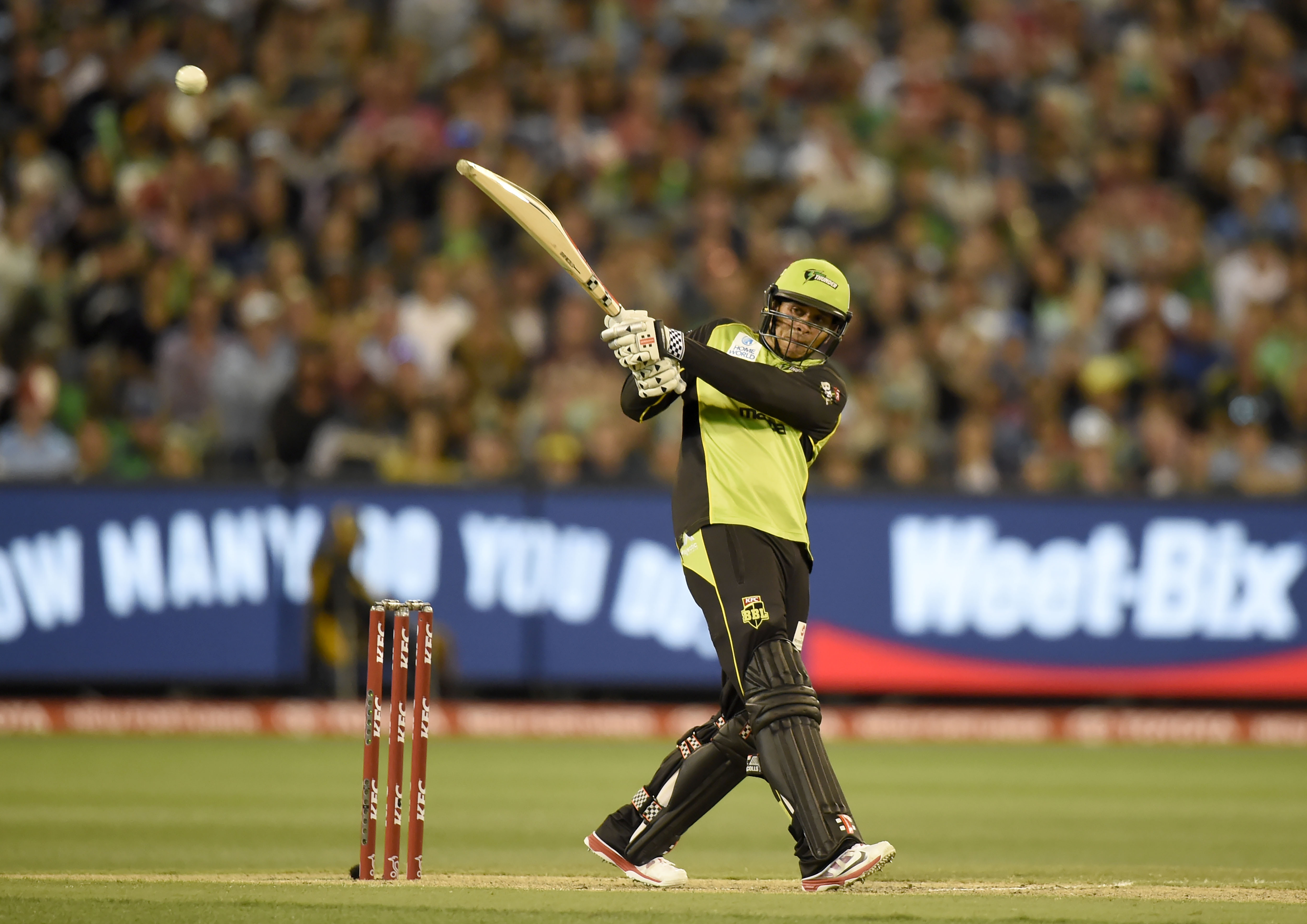 Usman Khawaja launches another ball towards the boundary in the Bash League Final. AAP Image/Mal Fairclough