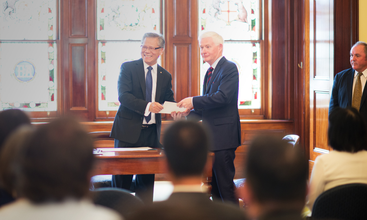 Deputy Premier John Rau (left) being sworn in by Governor Hieu Van Le to his new portfolios today.