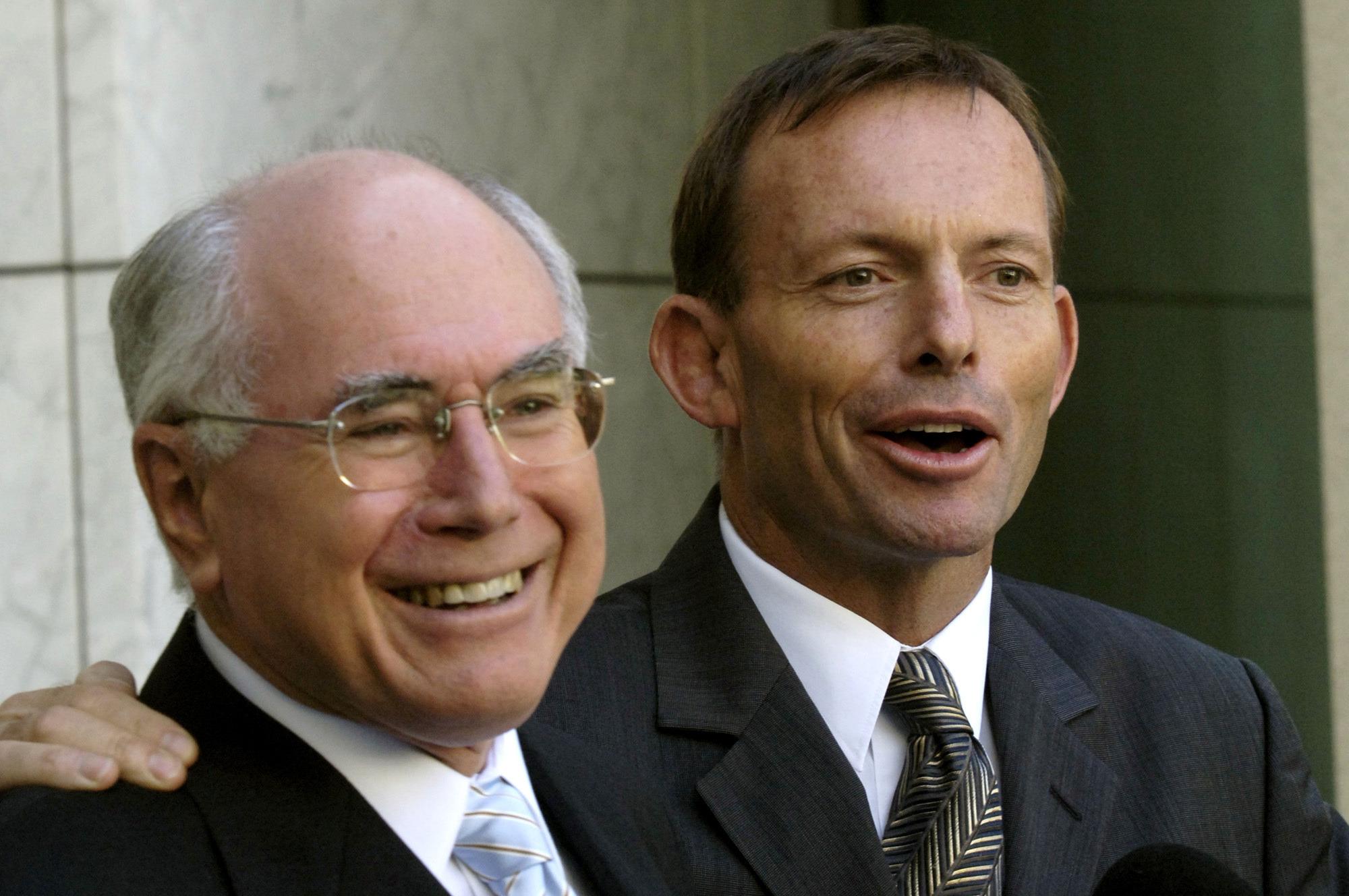 John Howard (left) with Tony Abbott in 2006. Photo: AAP/Alan Porritt