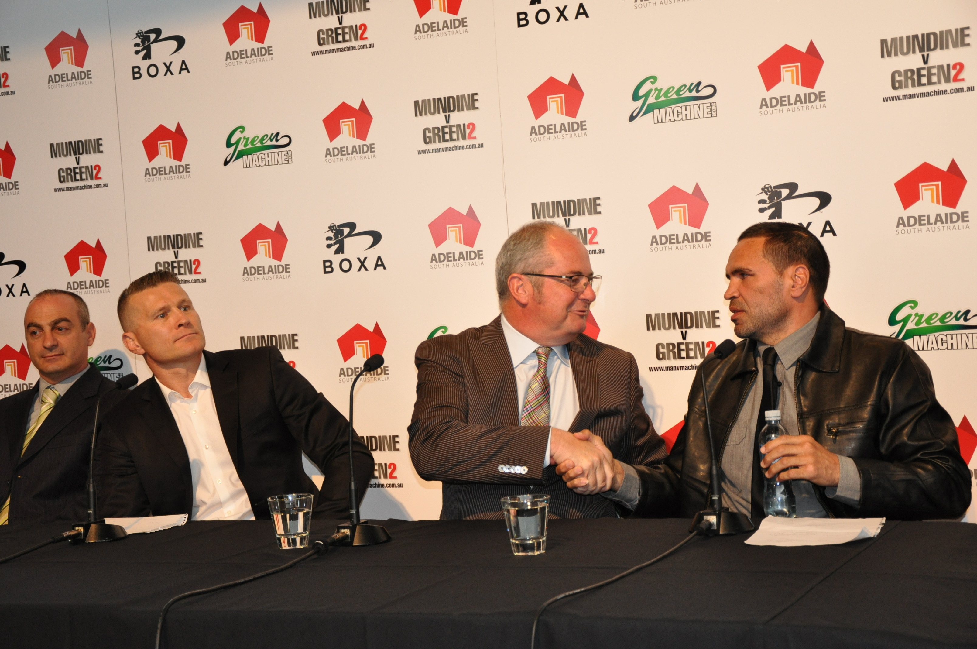 Tourism Minister Leon Bignell (centre) at today's announcement with Danny Green (left) and Anthony Mundine (right). Photo: AAP/Rick Goodman