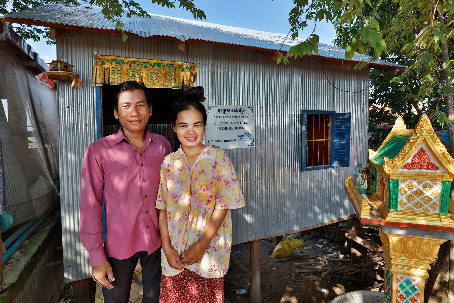 Sam Ouen and his wife outside their house in Kom Nor Thmor village - a new house like this costs $2000. Photo: Tony Lewis