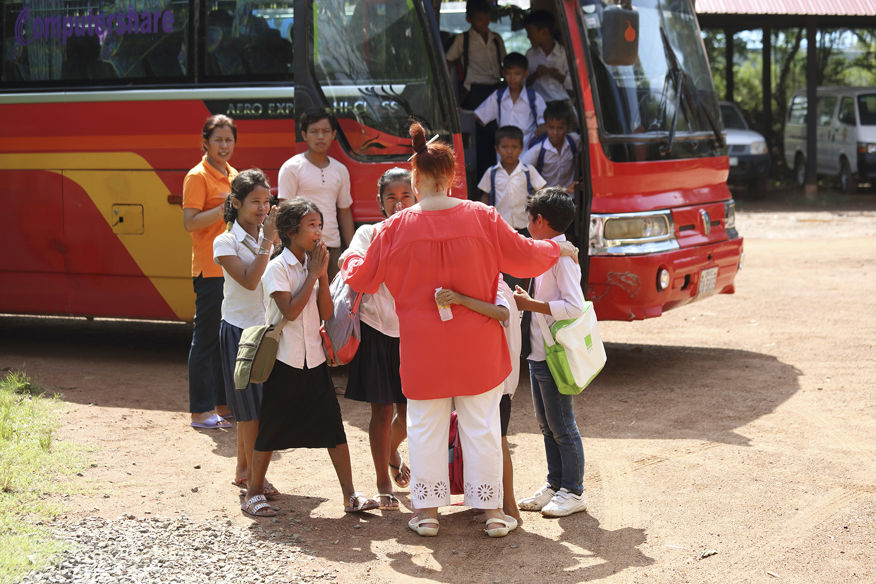 Geraldine Cox greets orphan children at Sunrise Kandal Province as they arrive home after from attending school for the morning. Photo: Tony Lewis