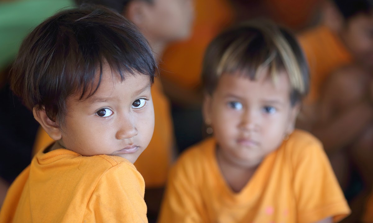 Young orphan children in class at the Sunrise school in Kandal Province. Photo: Tony Lewis