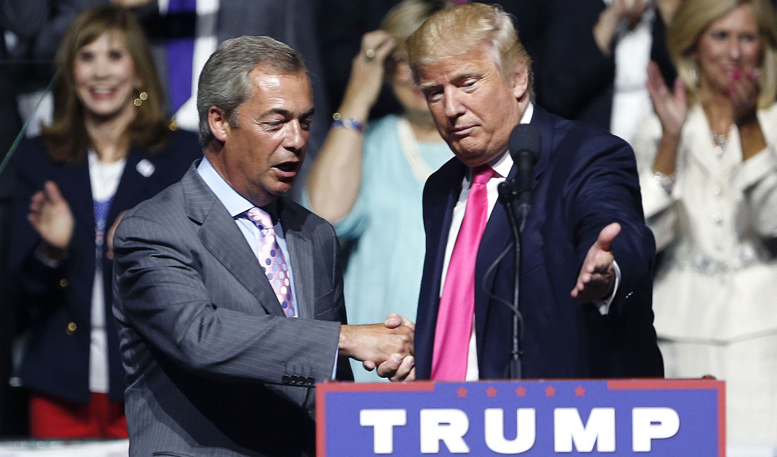 Brexiteer Nigel Farage joined Trump at a campaign rally in August. Photo: Gerald Herbert / AP