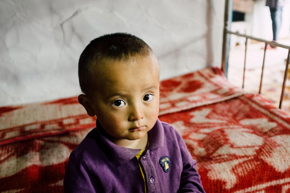 A little boy living on the Russia/Mongolia border. Photo: Ashton Papazahariakis