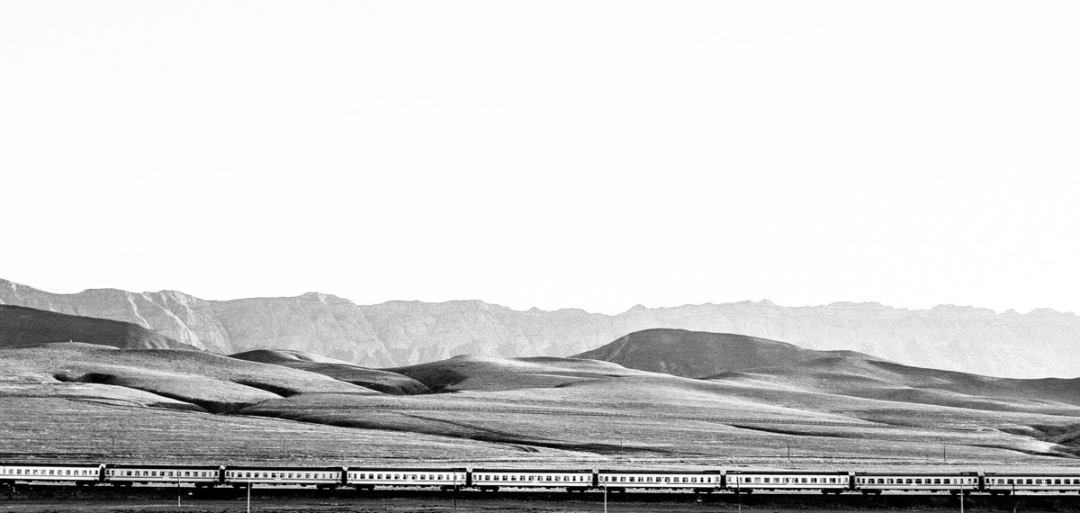A train crosses the desolate landscape of Turkmenistan, a country insulated from the world under three decades of oppressive rule. Photo: Ashton Papazahariakis