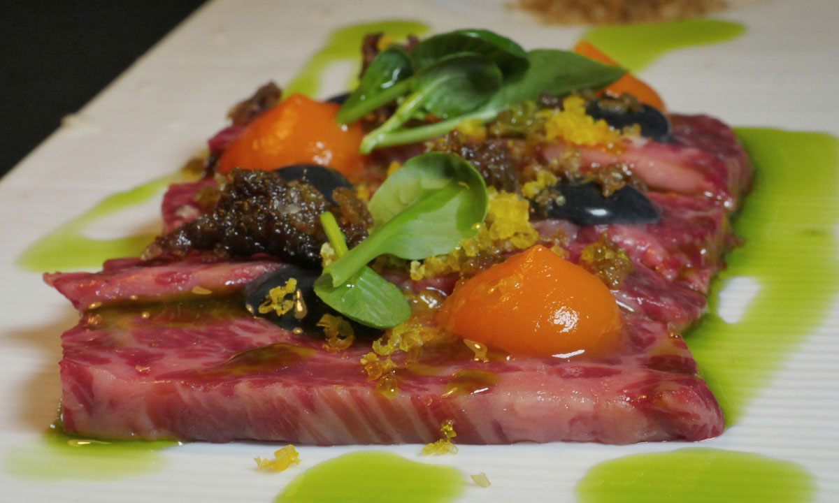 Waygu rump cap carpaccio with squid ink aioli, ham hock and cured duck egg. Photo: Dougal McFuzzlebutt