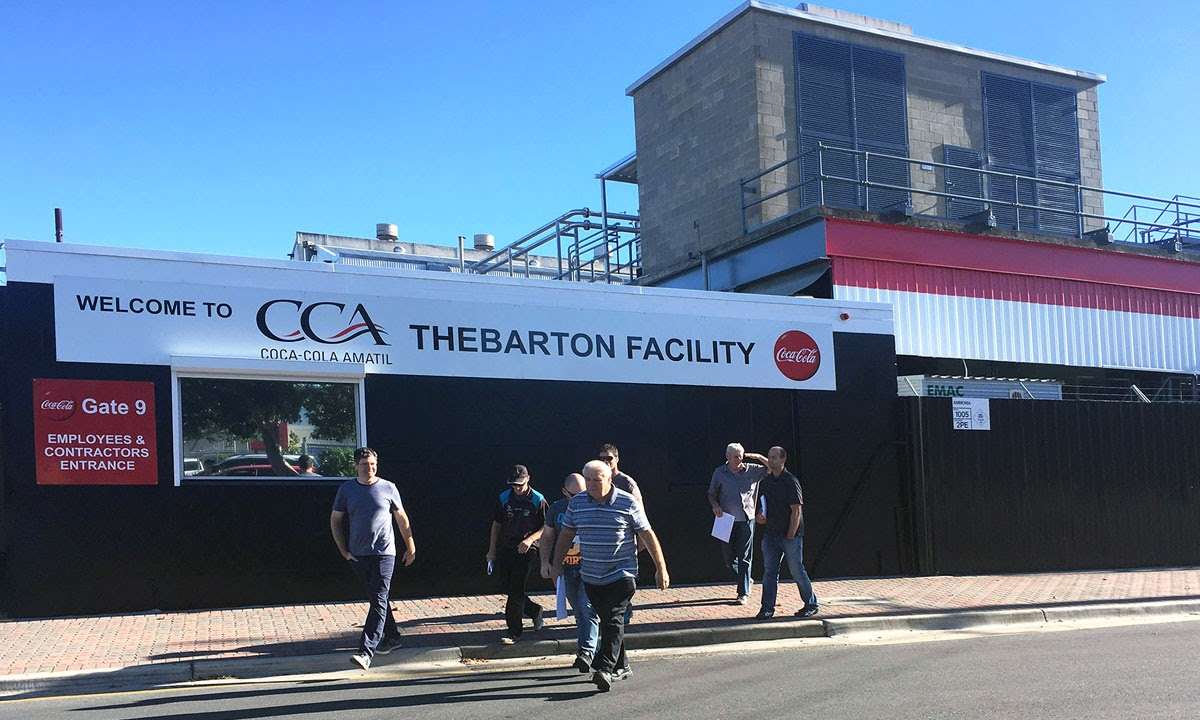Workers outside the Coca Cola Amatil plant at Thebarton this morning.