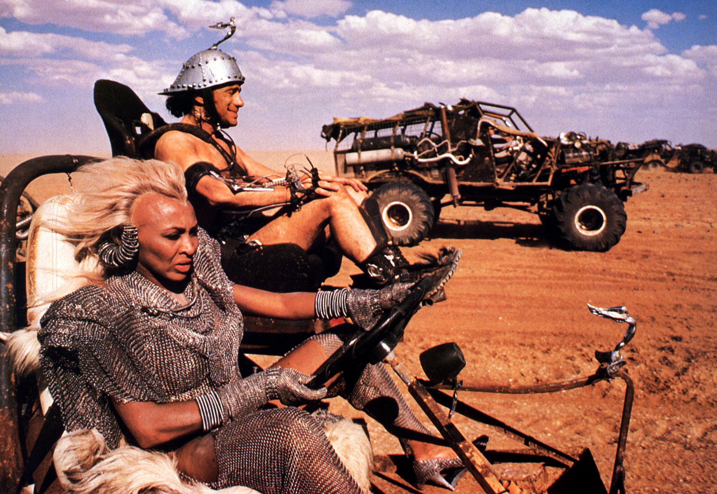 """""""Bigfoot"""" in the background of this still shot from Mad Max: Beyond Thunderdome (1985). Picture from the Ronald Grant Archive"""