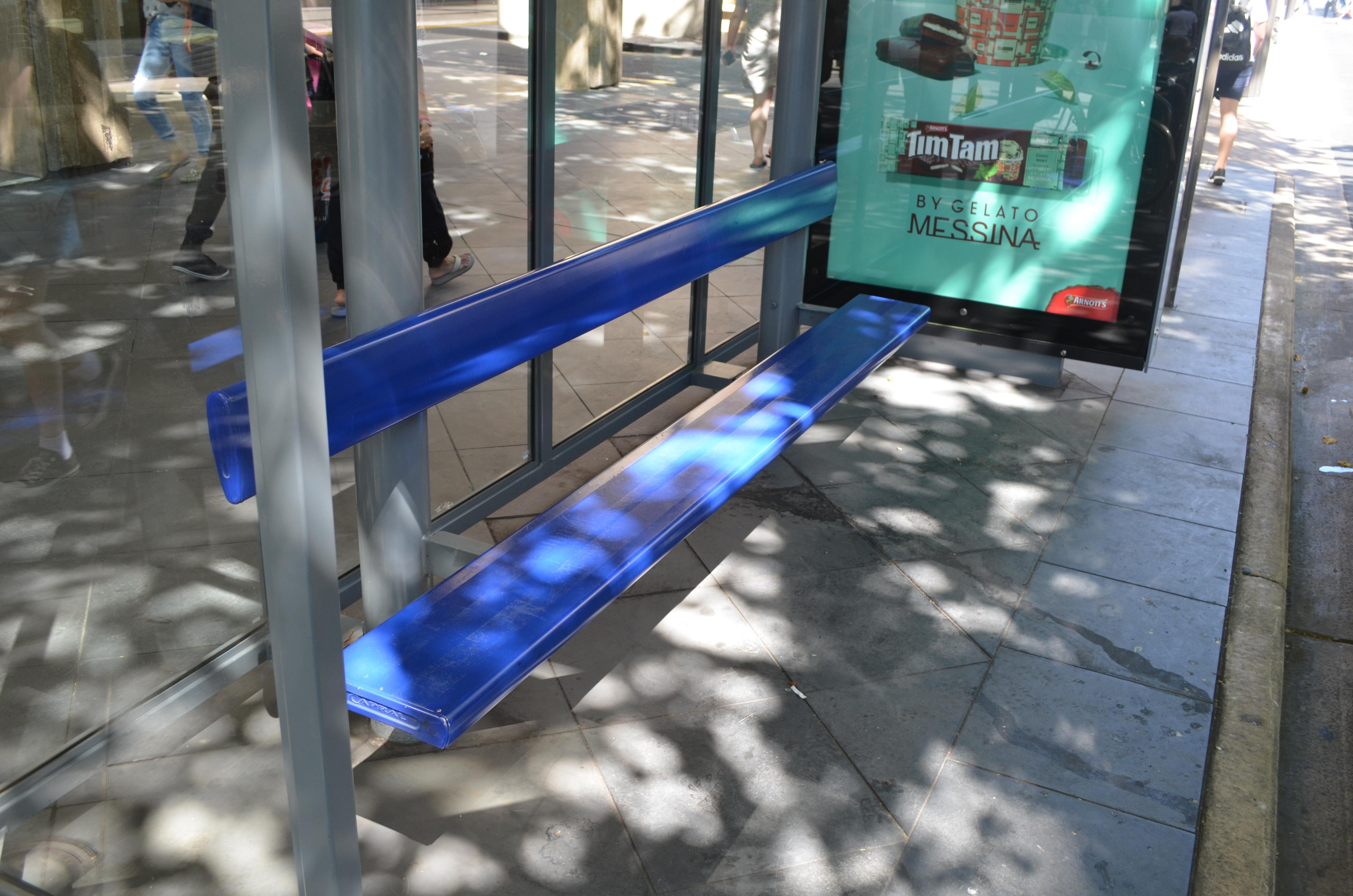 Thin metal bus stop seats.