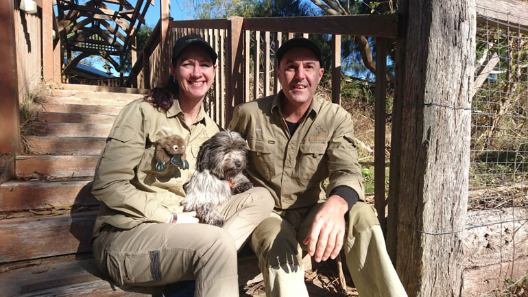 Warrawong Wildlife Sanctuary owners Narelle MacPherson and David Cobbold with four-legged friend, Bear. Photo courtesy of Weekender Herald.