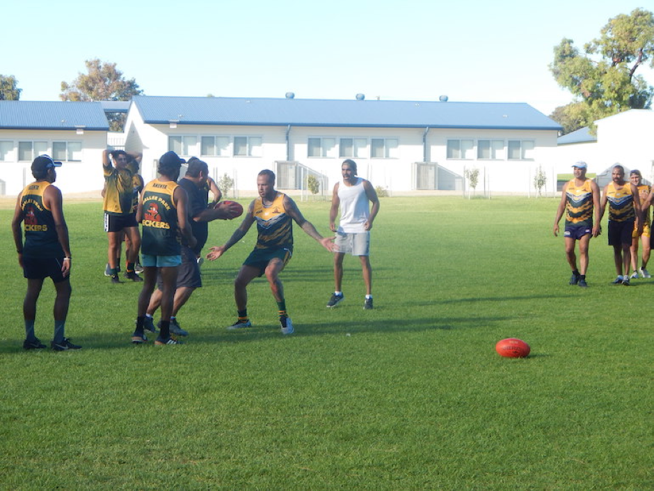 Crows star footballer and former Peckers player Eddie Betts, centre, trains with the team in Port Lincoln.